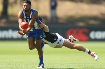 North Melbourne's Tarryn Thomas looks to dispose of the ball.