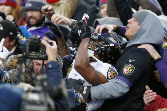 Marcus Peters jumps into the crowd to celebrate breaking up a pass during the fourth quarter against the Buffalo Bills.