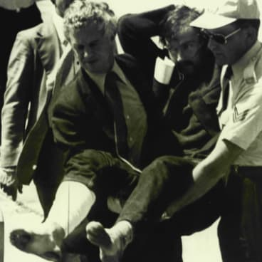February 15, 1977: Edwin John Eastwood is carried from a plane at Essendon Airport after being shot in the leg and captured.