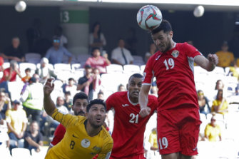 Head for heights: Anas Bani Yaseen heads home the winning goal for Jordan.