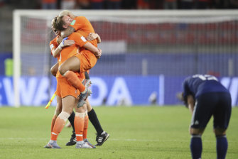Agony and ecstasy: Dutch players celebrate their win as their Japanese counterparts are sent crashing out of the World Cup.