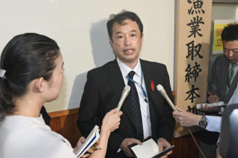 An official of the Japanese Fisheries Agency speaks to media following the collision.