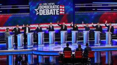 Democratic presidential candidates raise their hands when asked if they would provide healthcare for undocumented immigrants.