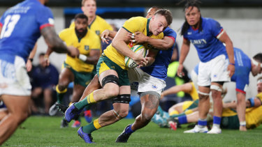 Jack Dempsey carries the ball in Australia's 34-15 win over Samoa on Saturday night.