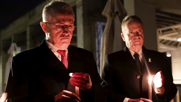 Prime Minister Malcolm Turnbull and Opposition Leader Bill Shorten attend a candlelight vigil for Eurydice Dixon, at Parliament House in Canberra.