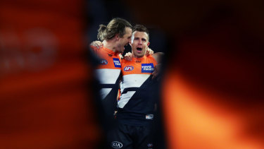 Phil Davis and Brett Deledio belt out the GWS Giants club song after beating the Western Bulldogs.