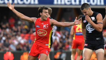 Eclipsed: Jack Bowes boots the winning goal for Gold Coast with just 13 seconds remaining on the clock.