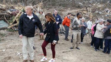 Donald Trump and Melania in Alabama with tornado victims.
