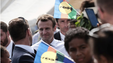 French President Emmanuel Macron is surrounded by independence Kanak flags on Ouvea Island, off New Caledonia, on Saturday, May 5.