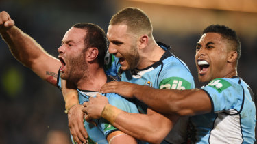 Tease: Boyd Cordner, Robbie Farah and Michael Jennings celebrate the former's try in game one.