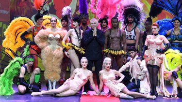 """Jean Paul Gaultier with the cast of his revue at Paris's Folies Bergère. """"I would pick girls I saw in clubs in London and Paris,"""" he says."""
