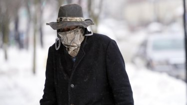 A pedestrian wears a face mask to protect him from the cold in Pittsfield, Massachusetts, this week.