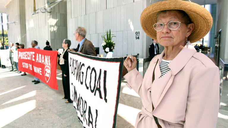 Adani protesters are seen occupying the foyer of the Queensland government headquarters at 1 William Street.