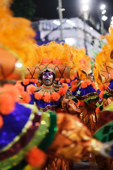 All the colour of Rio. Performers from Academicos do Grande Rio samba school during Carnival celebrations.