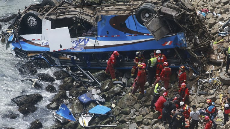 """The scene of the accident in January when 51 people died after a bus plunged off a cliff along a foggy stretch of road, known as the """"devil's curve."""""""
