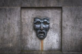 A bronze theatre mask on Edinburgh's Royal Mile in Scotland.