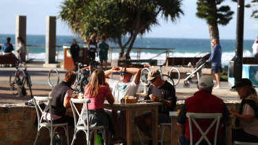 People dine in at Surfers Paradise under 10-person limits.
