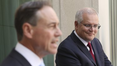 Health Minister Greg Hunt (left) has distanced himself from the internal ructions, which threaten to draw in Prime Minister Scott Morrison.