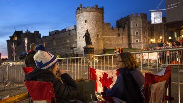 A group of woman from Canada sit outside Windsor Castle, England, on Thursday.