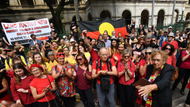 Wangan and Jagalingou traditional owners and their supporters protesting outside Parliament House in Brisbane in March last year.