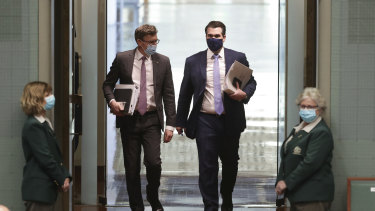 Ministers Alan Tudge and Michael Sukkar wearing masks on arrival for Question Time on Monday.