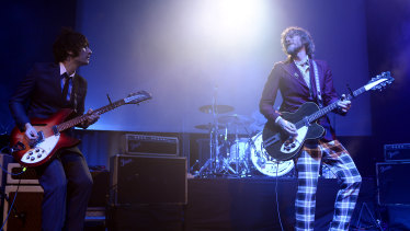 Davey Lane, left, and Tim Rogers of You Am I on stage at Melbourne's Forum Theatre in July 2013.