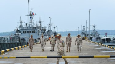 Navy personnel walk on a jetty at the Ream Naval Base in Cambodia during a government-organised media tour last year.