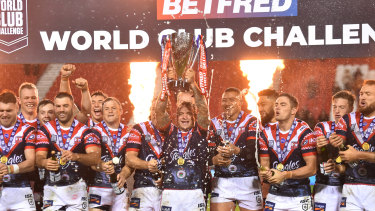 Jake Friend lifts the World Club Challenge trophy at Totally Wicked Stadium in St Helens.