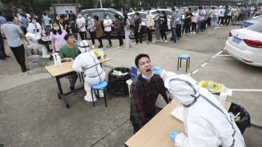 Workers line up for a coronavirus test at a large factory in Wuhan in May.