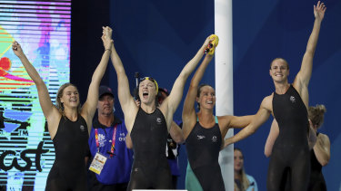 The Australians celebrate their record-breaking win.