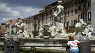 A child admires the 1575 Fontana del Moro in Rome's Piazza Navon.
