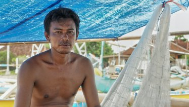 Oli, a fisherman from Kedonganan fishing village on his fishing boat.