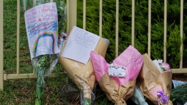 Flowers and cards left at the scene.