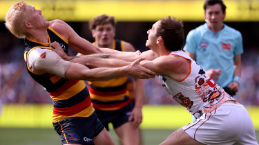 Elliott Himmelberg competes with Jeremy Finlayson. The Giants outmuscled the Crows throughout Saturday's clash.