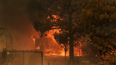 A house on fire that could not be saved in the fires on the outskirts of Bargo, NSW on Thursday.