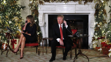 Donald Trump and first lady Melania Trump talking to children on Christmas Eve to share updates on Santa's movements from the North American Aerospace Defense Command (NORAD) Santa Tracker on Christmas Eve.