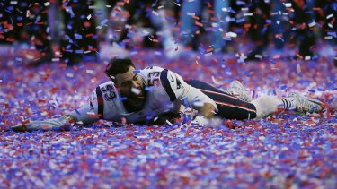 New England's Kyle Van Noy celebrates in confetti after game.