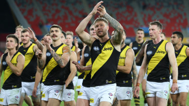A victorious Richmond leave the Gold Coast ground.