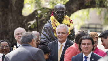 Mayor of Parramatta Andrew Wilson (far left, obscured) and Prime Minister Scott Morrison at the unveiling of a statue of Mahatma Ghandi at Jubilee Park in Parramatta in November 2018. Cr Barrak is in the foreground.