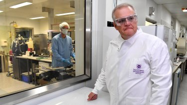 Prime Minister Scott Morrison at the University of Queensland. The vaccine venture had to be abandoned when it was discovered that participants given the trial vaccine started returning false positives for HIV tests.