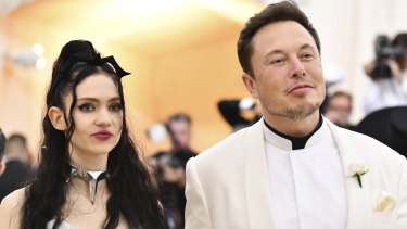 The SEC said Musk came up with the price in attempt to impress his girlfriend, rapper Grimes.