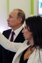 Russian President Vladimir Putin and with editor-in-chief of RT, Margarita Simonyan, in 2015.