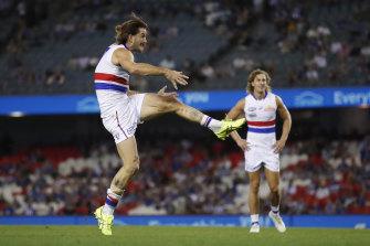The Bulldogs' Josh Bruce kicks his 10th goal in the big win over the Kangaroos.