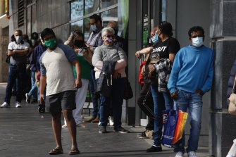 People lining up for a COVID vaccination. The pandemic, and its impact on the overall economy, remains the Reserve Bank's focus.