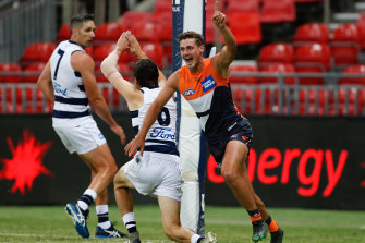 Harry Perryman celebrates a goal in Saturday night's win over Geelong.