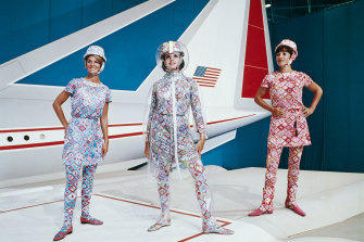 Hostesses model 1970s Pucci uniforms in front of Lockheed's supersonic transport full-size mockup.