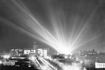 Search lights create a flare of light over Melbourne in 1945.