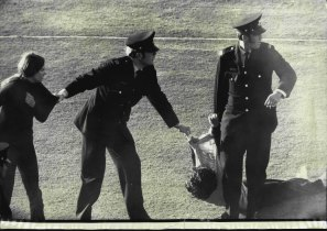 Verity Burgmann standing and Meredith Burgmann on the ground being dragged from the pitch at Springbok demonstrations at the SCG on July 6, 1971.