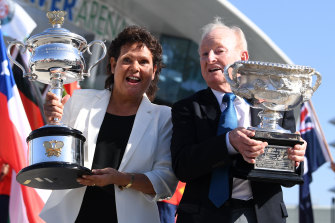 Evonne Goolagong Cawley and Rod Laver hold the men's and women's trophies on day one of the Australian Open last year.