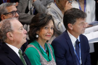 Angus Taylor, right, attends the UN climate summit in Madrid. He is pictured with Michael Bloomberg, left, and Spanish Banco Santander bank's chairwoman, Patricia Botin.